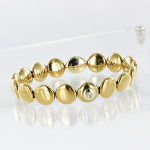 Armband aus goldem Keramik mit Brillant